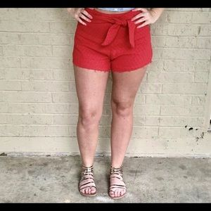 High waisted shorts with tie, side zipper & clasp.